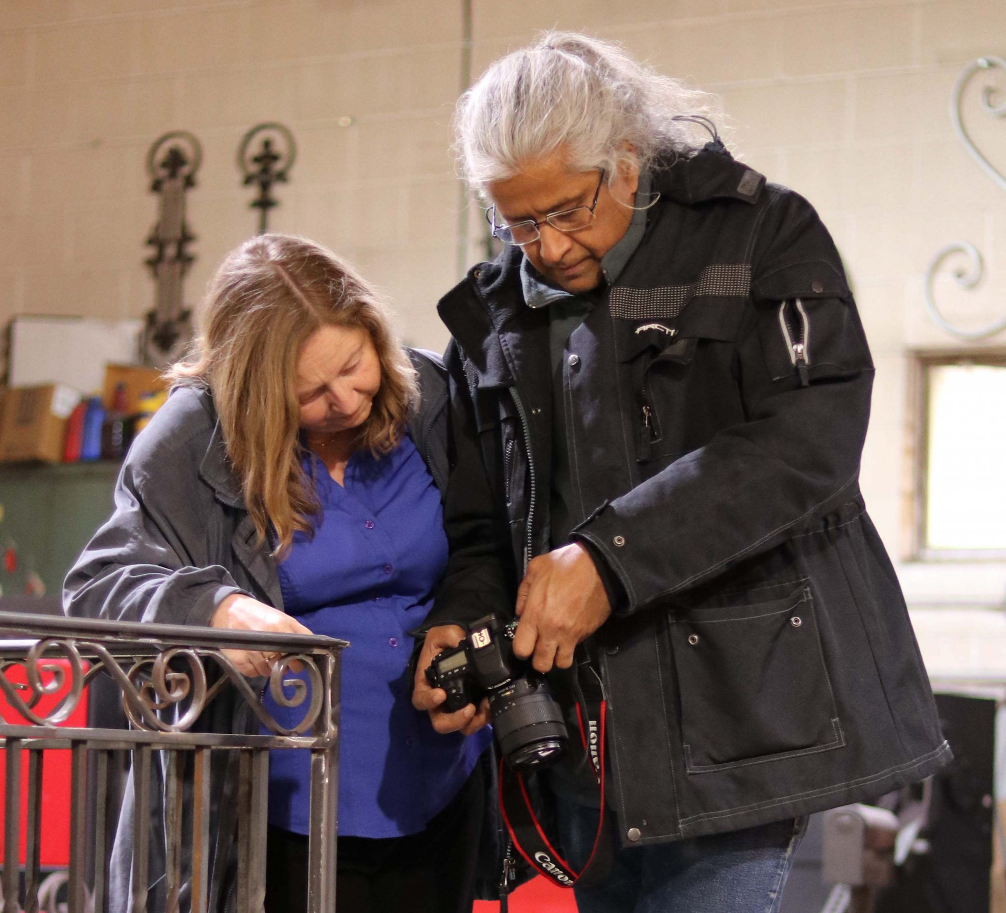 Guha Shankar assists Beth Bevars with her camera