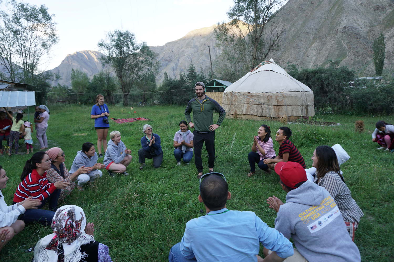 People play a Kyrgyz children's game outside yurts