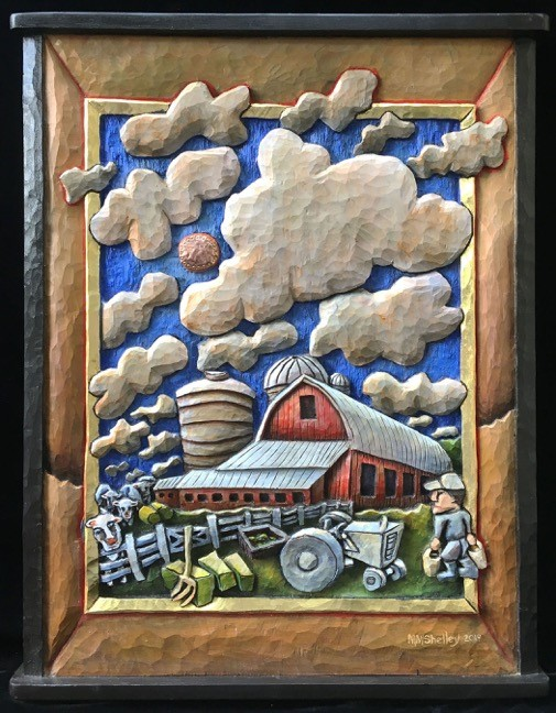 Wood carving of red barn with big sky