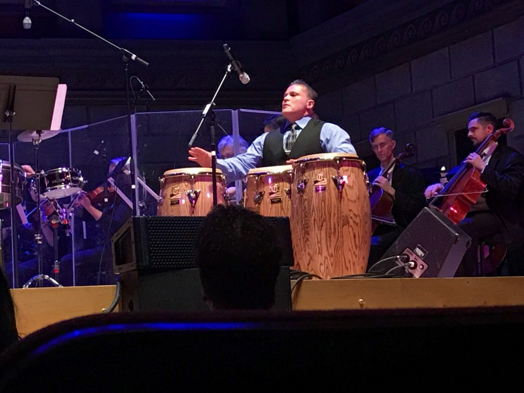 Toby Padilla playing percussion drums on stage